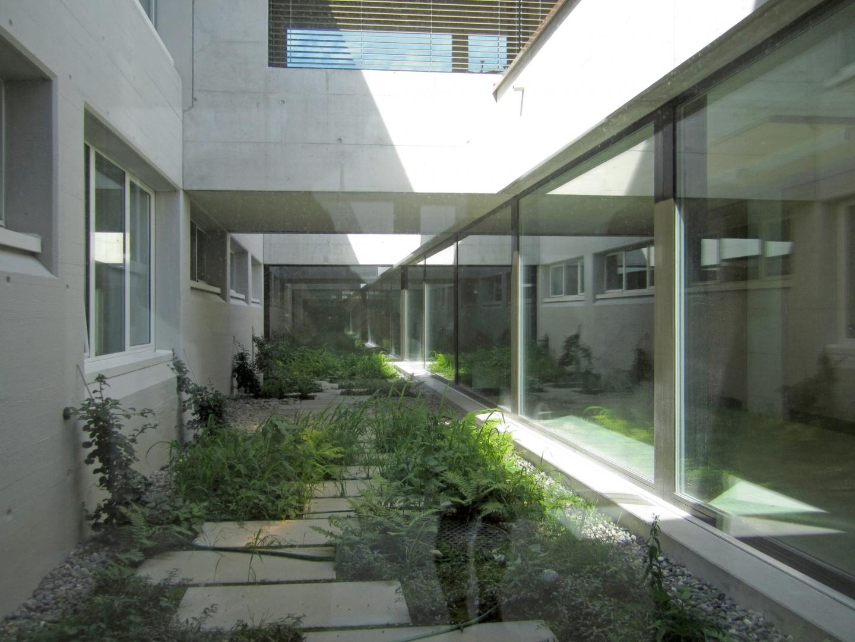 Lichthof zwischen Alt- und Neubau © Hopf & Wirth Architekten, Rychenbergstrasse 2,  8400 Winterthur