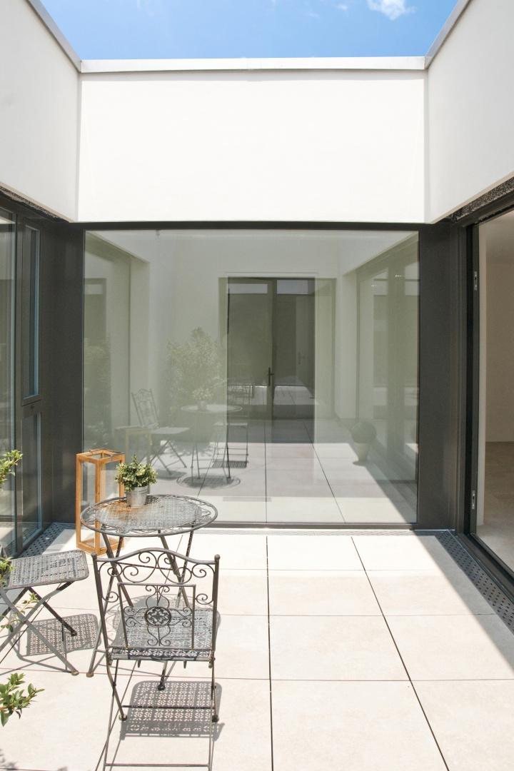 Stollturm Gartenhaus Patio © Architektur Rolf Stalder AG