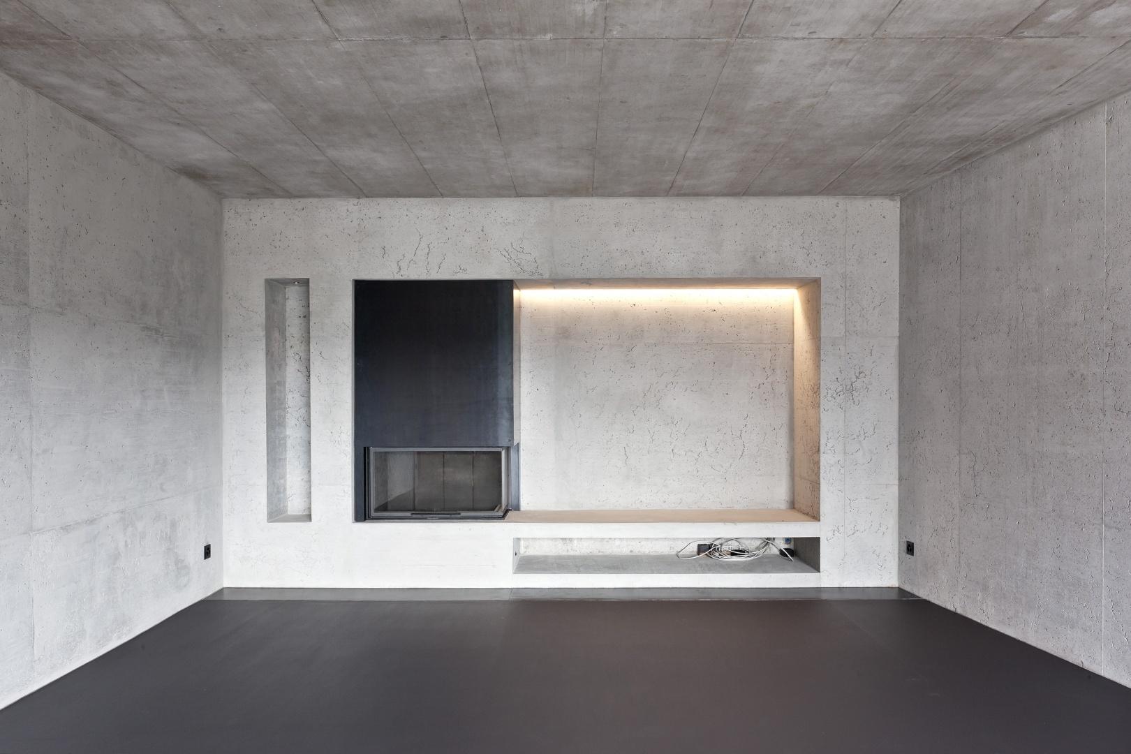 Wohnraum mit Cheminée © KREN Architektur AG
