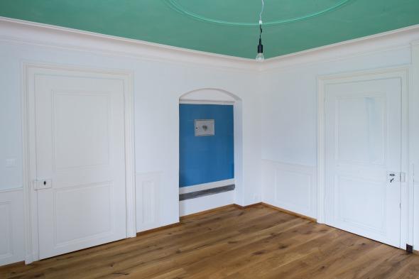 Grünes Zimmer mit historischem Kachelofen © Fotostudio Fischlin