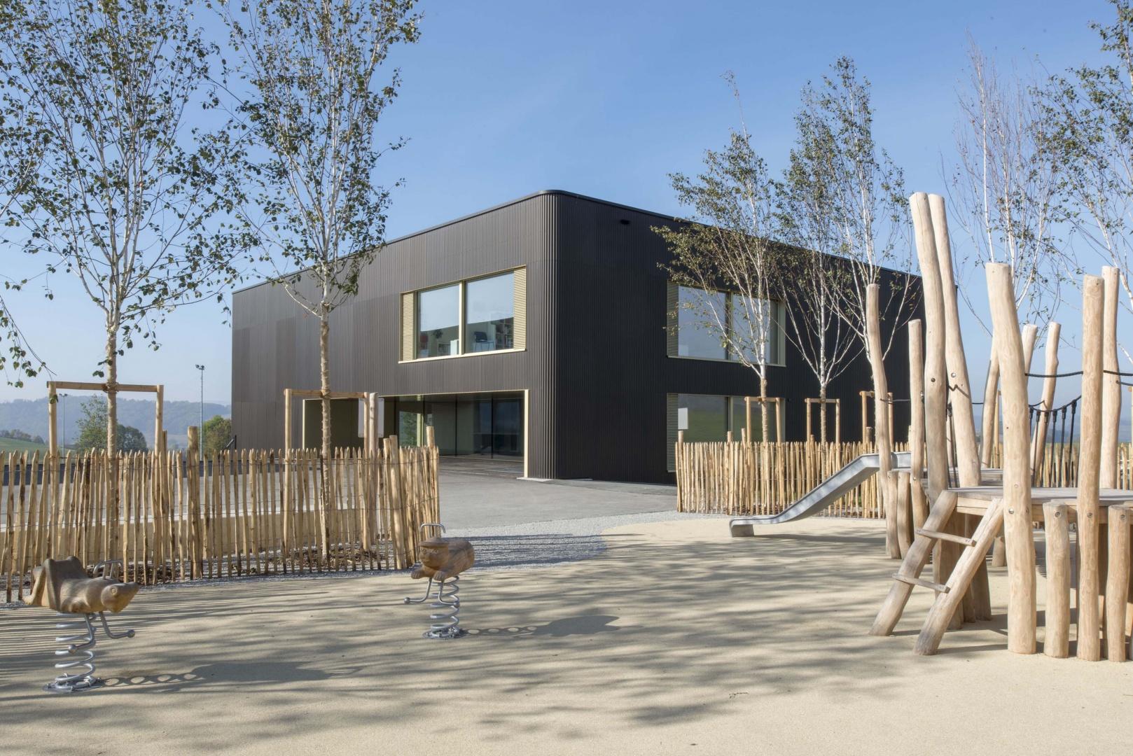 Spielplatz im Aussenbereich © Projet et réalisation : Ruffieux-Chehab Architectes SA, Photos : Primula Bosshard