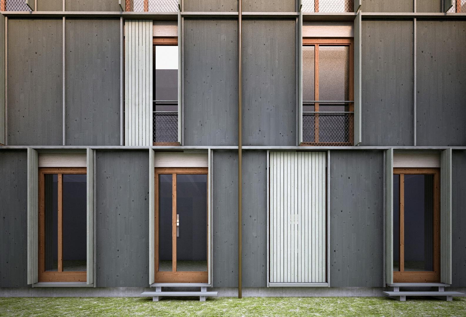 Portion de la construction bois en façade sur la Maiengasse: bardage vert foncé en sapin, fenêtres à la française en mélèze et volets battants lasurés en gris-vert. © Esch Sintzel