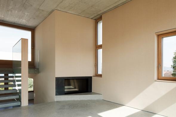 Cheminee im überhohen Wohnraum inkl. Zugang Dachterasse (Seesicht) © Beat Bühler