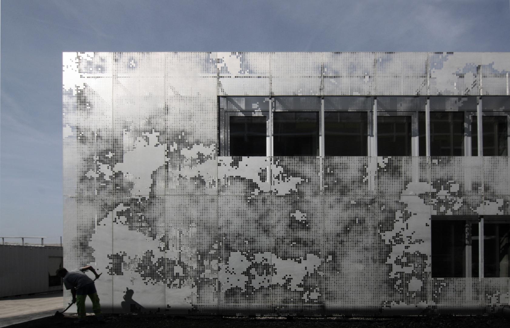 Façade perforée B3 © Guenin Huni Architectes