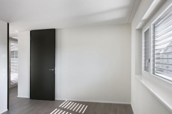 Zimmer mit Abschluss zu Korridor © Andreas Marti & Partner Architekten AG