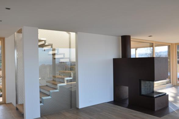 Wohnbereich mit Feuerstelle EG © 2m-architektur gmbh