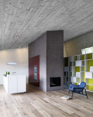 Küche mit Küchenkern in Beton