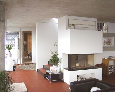 Wohnzimmer mit Kamin © BGS&Partner Architekten AG