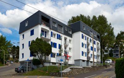 Rénovation énergétique et surélévation bois d'un immeuble d'habitation