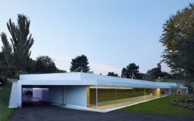 Agrandissement d'une villa avec piscine intérieure